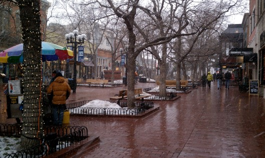 Snow starting to fall on Pearl Street in Downtown Boulder