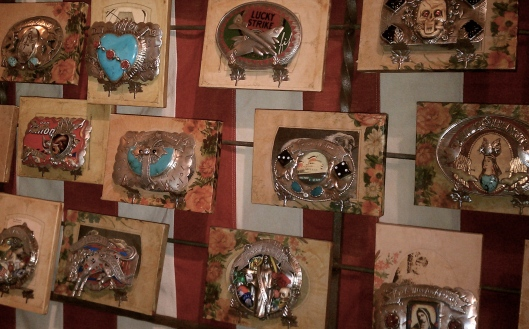 Wall Of Belt Buckles at Sweet Letter Press