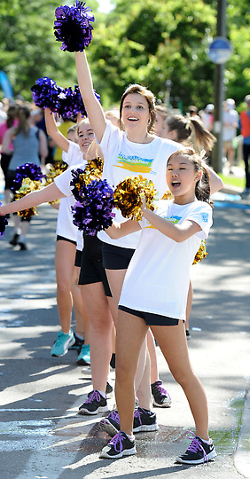 Girls cheering for The 2012 Bolder Boulder