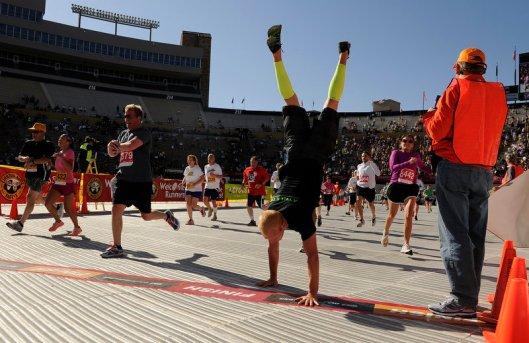 Guys handstands at finish of 2012 Bolder Boulder